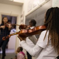 In Connecticut, an after-school arts program has partnered with a local resettlement agency to create a special violin class for young refugees. (Ryan Caron King/WNPR)