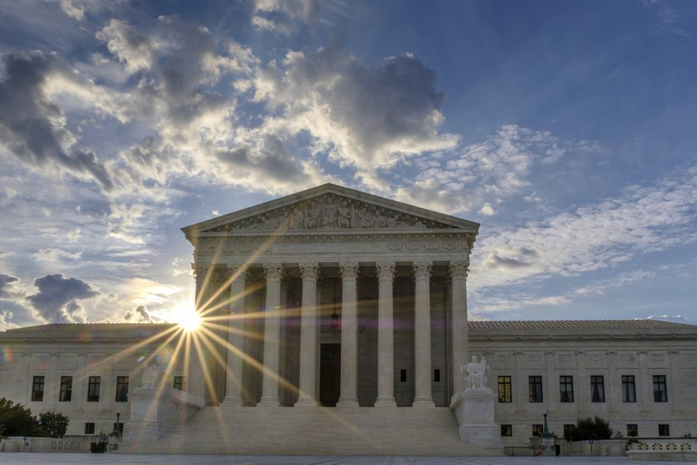The sun rises behind the U.S. Supreme Court building in Washington on Sunday. (J. David Ake/AP)