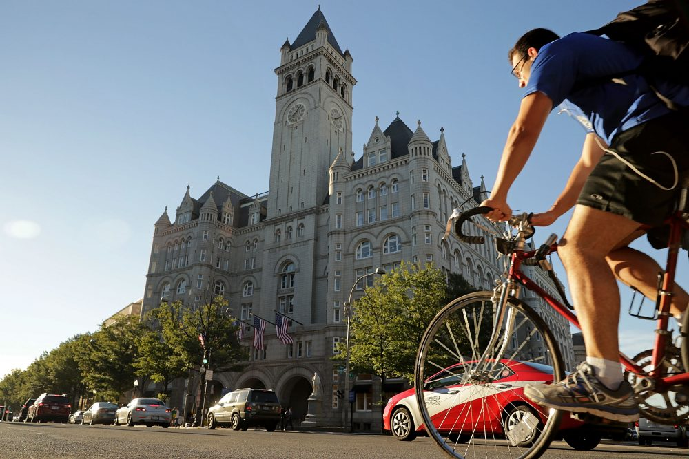 Morning traffic flows past the Trump International Hotel on its first day of business Sept. 12, 2016 in Washington. (Chip Somodevilla/Getty Images)