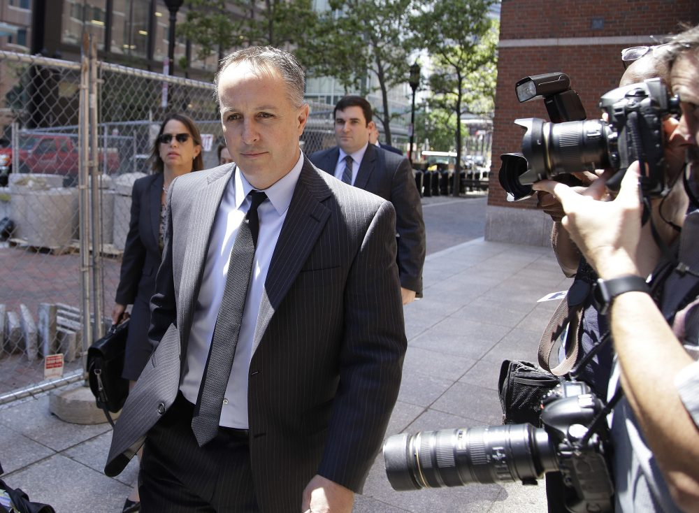 Barry Cadden, president of the New England Compounding Center, followed by members of his legal team, arrive at the federal courthouse in Boston for his sentencing. (Stephan Savoia/AP)