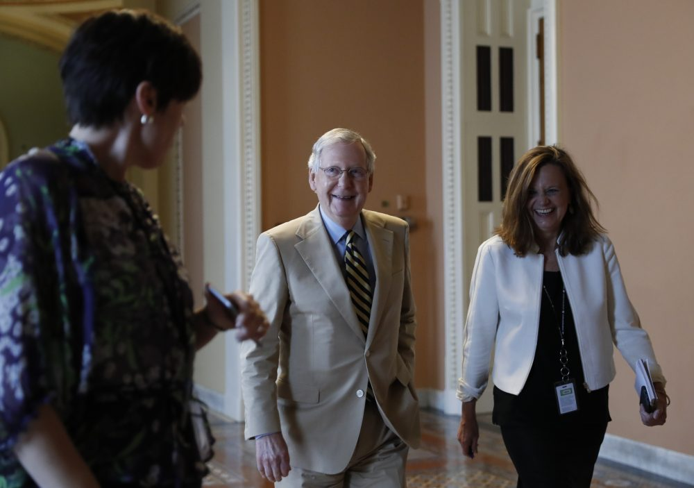 """Senate Majority Leader Mitch McConnell (R-Ky.), center, talks with his chief of staff Sharon Soderstrom, right, and communications staff director Antonia Ferrier, left, as they walk to his office on Capitol Hill in Washington, Monday, June 26, 2017. Senate Republicans unveil a revised health care bill in hopes of securing support from wavering GOP lawmakers, including one who calls the drive to whip his party's bill through the Senate this week """"a little offensive."""" (Carolyn Kaster/AP)"""