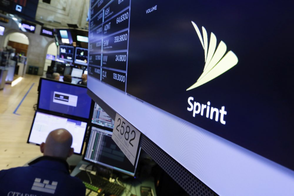 The Sprint logo appears above a trading post on the floor of the New York Stock Exchange, Tuesday, June 27, 2017. Sprint climbed 5.8 percent following a published report suggesting the mobile phone company is in talks with Charter Communications and Comcast Corp. on a deal that could enable the cable operators to buy a stake in Sprint. (Richard Drew/AP)
