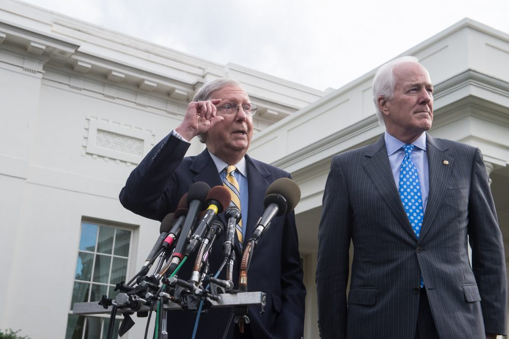Senate Majority Leader Mitch McConnell (left) and Majority Whip John Cornyn speak to the press outside the West Wing of the White House after Republican senators met with President Trump to discuss the health care bill in Washington, D.C., on June 27, 2017. (Nicholas Kamm/AFP/Getty Images)