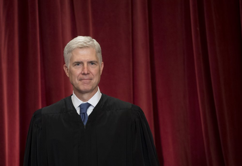 Supreme Court Associate Justice Neil Gorsuch stands for an official photo with other members of the U.S. Supreme Court in Washington, D.C., June 1, 2017. (Saul Loeb/AFP/Getty Images)