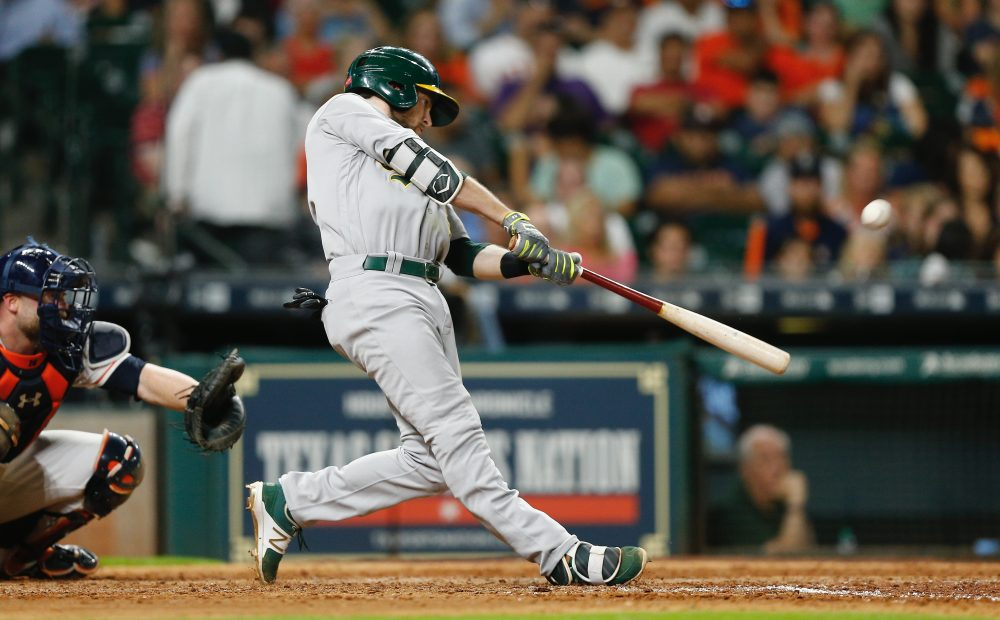 Jed Lowrie of the Oakland Athletics hits a home run in the seventh inning against the Houston Astros at Minute Maid Park on June 28, 2017 in Houston, Texas. (Bob Levey/Getty Images)