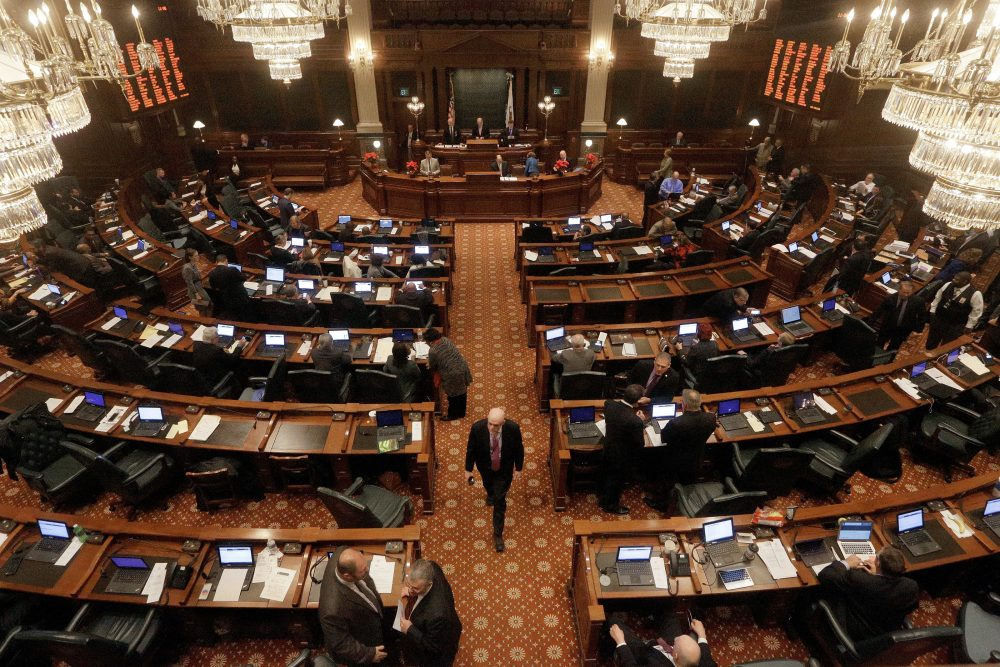 After almost two years without a state budget, lawmakers in Illinois are scrambling to hammer out a deal before the fiscal year ends Friday. Pictured: A veto session at the Illinois State Capitol in 2016 in Springfield, Ill. (Seth Perlman/AP)