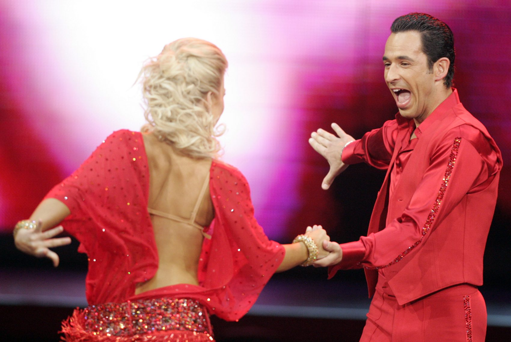 Auto racer Helio Castroneves, right, performs with Julianne Hough on the TV show Dancing With The Stars. (AJ Mast/AP)