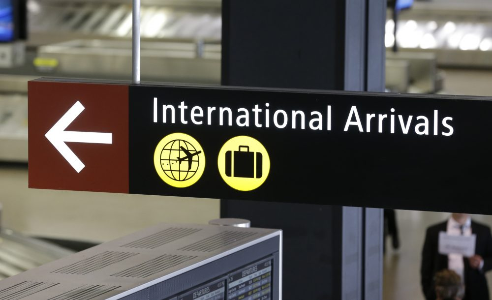 A sign for International Arrivals is shown at the Seattle-Tacoma International Airport, Monday, June 26, 2017, in Seattle. (Ted S. Warren/AP)