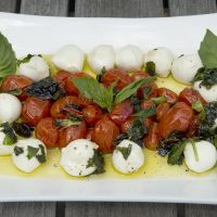 Kathy's roasted cherry tomato and basil caprese salad. (Robin Lubbock/WBUR)