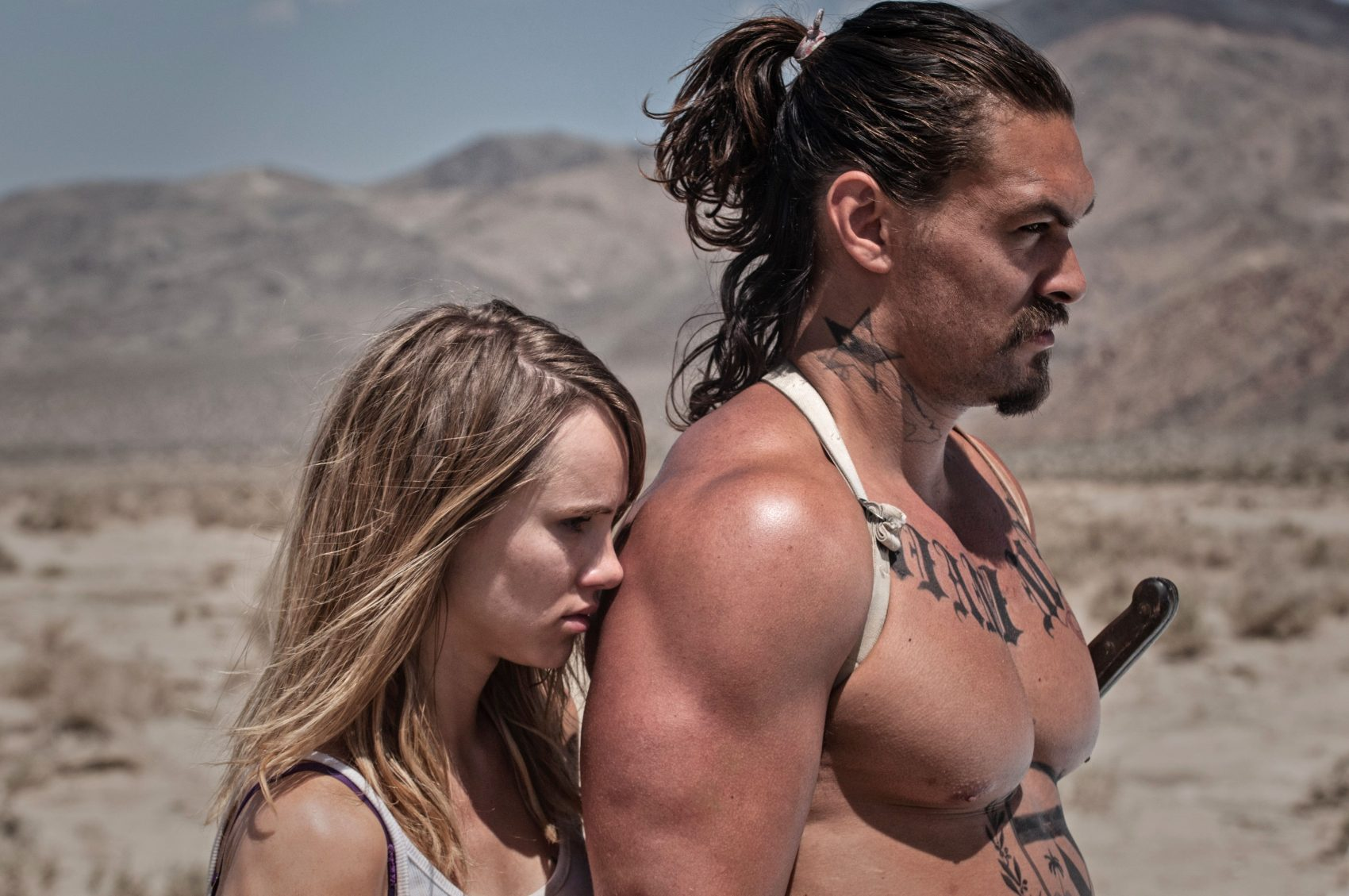 "Arlen, played by Suki Waterhouse, and Miami Man, played by Jason Momoa, brace for a fight in ""The Bad Batch."" (Courtesy NEON)"