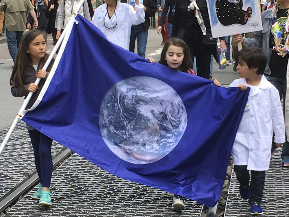 Moral progress on this scale isn't convenient, writes Steve Almond. But it's also not impossible. In this photo, demonstrators in support of the March for Science walk up Market Street en route to City Hall in downtown San Francisco Saturday, April 22, 2017. (Olga Rodriguez/ AP)