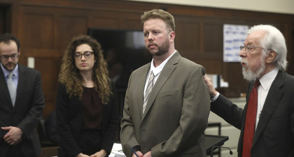 Defense attorney Jonathan Shapiro, right, introduces Michael McCarthy, second right, to potential jurors as jury selection begins for McCarthy's murder trial last month. (Pat Greenhouse/The Boston Globe via AP, Pool)