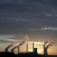 In 2015, 78 percent of Massachusetts voters said they believed the world was getting warmer. Today it's 88 percent -- and the public is coalescing around the cause. Here, the coal-fired Plant Scherer, one of the nation's top carbon dioxide emitters, stands in the distance in Georgia. (Branden Camp/AP)