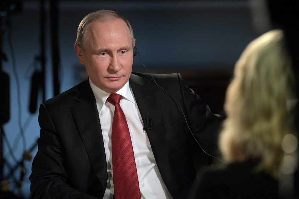 """In this Saturday, June 3, 2017, photo released Monday, June 5, 2017, Russian President Vladimir Putin faces an interview with NBC's """"Sunday Night with Megyn Kelly"""" in St. Petersburg, Russia .Putin says claims about Russian involvement in U.S. elections are untrue, and says the United States actively interferes with elections in other countries. (Alexei Druzhinin, Sputnik, Kremlin Pool Photo via AP)"""