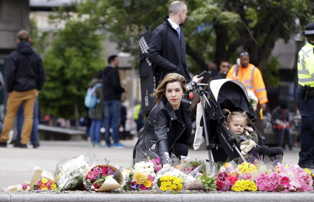 What's a parent to do? We have already emphasized the importance of wearing a seatbelt and a bike helmet, writes Holly Robinson. Now we have to remind our children to wear running shoes in case there's an attack. In this photo, a woman lays a bouquet of flowers in the London Bridge area of London, Monday, June 5, 2017. Police arrested several people and are widening their investigation after a series of attacks described as terrorism killed several people and injured more than 40 others in the heart of London on Saturday. (Alastair Grant/ AP)