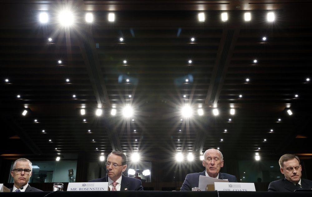 FBI Acting Director Andrew McCabe, left, Deputy Attorney General Rod Rosenstein, Director of National Intelligence Dan Coats, and National Security Agency director Adm. Mike Rogers are seated during a Senate Intelligence Committee hearing about the Foreign Intelligence Surveillance Act, on Capitol Hill, Wednesday, June 7, 2017, in Washington. (Alex Brandon/AP)