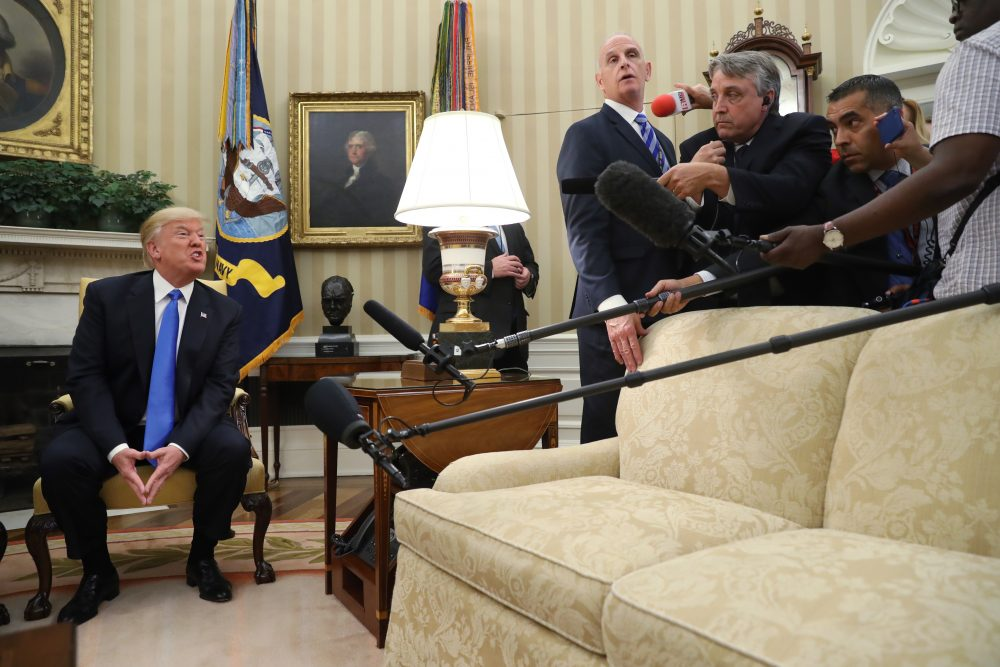 President Donald Trump answers a question from the media, during a meeting with Romanian President Klaus Werner Iohannis, not shown, in the Oval Office at the White House, Friday, June 9, 2017, in Washington. (Andrew Harnik/ AP)