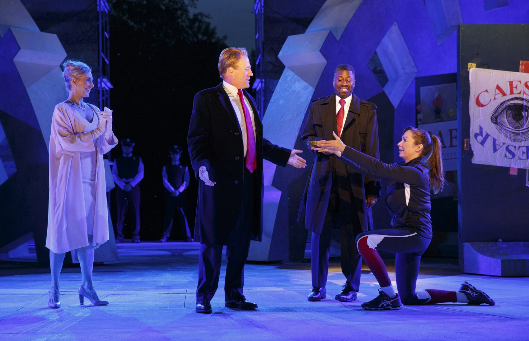 "Tina Benko, left, portrays Melania Trump in the role of Caesar's wife, Calpurnia, and Gregg Henry, center left, portrays President Trump in the role of Julius Caesar during a dress rehearsal in May of The Public Theater's production of ""Julius Caesar"" in New York. (Joan Marcus/The Public Theater via AP)"