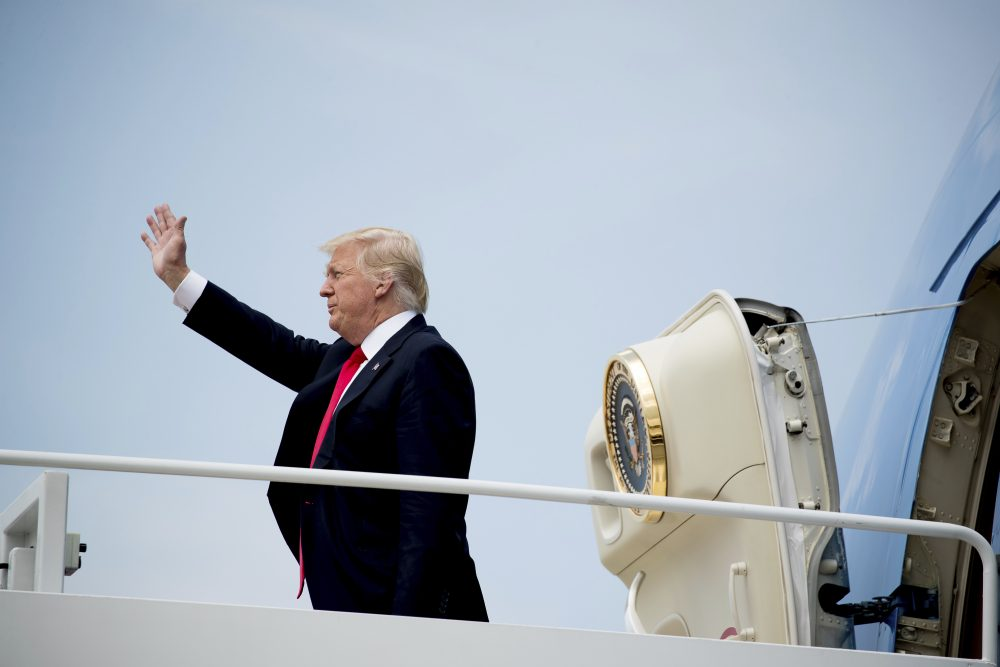 President Trump waves as he boards Air Force One at Andrews Air Force Base on Tuesday. (Andrew Harnik/AP)