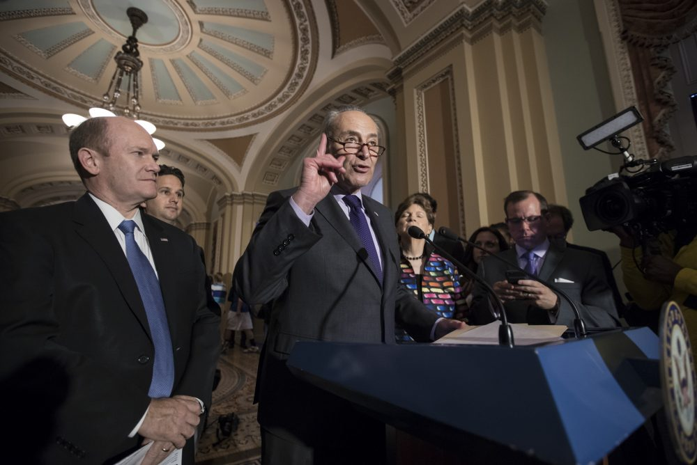"""Senate Minority Leader Chuck Schumer, D-N.Y., joined by, from left, Sen. Chris Coons, D-Del., Sen. Brian Schatz, D-Hawaii, and Sen. Jeanne Shaheen, D-N.H., speaks about the health overhaul following a closed-door strategy session at the Capitol in Washington, Tuesday, June 20, 2017. Senate Majority Leader Mitch McConnell says Republicans will have a """"discussion draft"""" of a GOP-only bill scuttling former President Barack Obama's health care law by Thursday. (J. Scott Applewhite/AP)"""