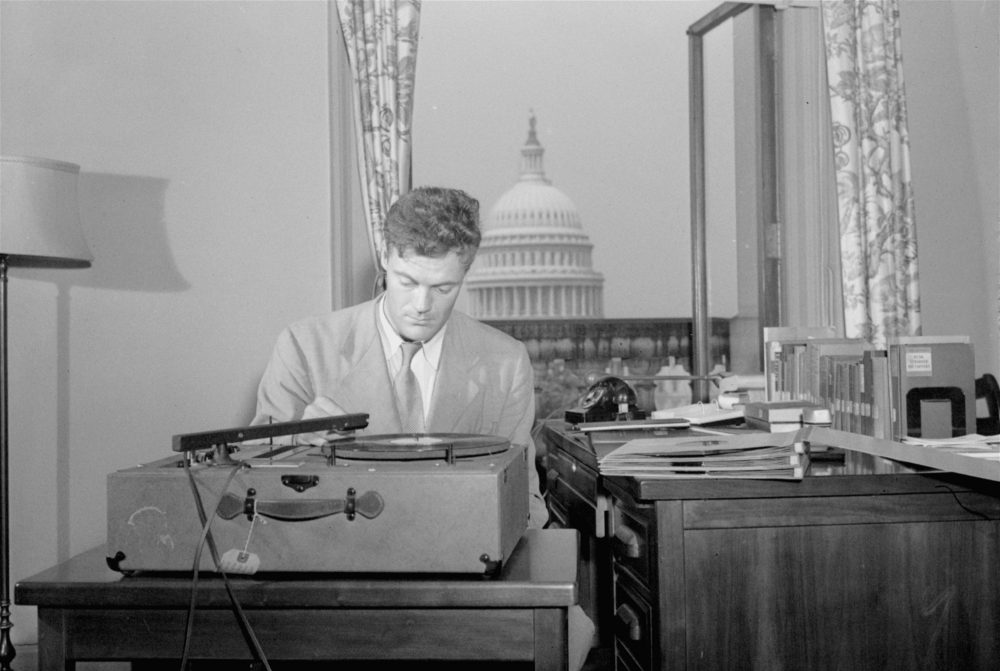 Robert Lowell, Jr., Library of Congress consultant in poetry in English, listens to a playback of a new recording of poetry in his office in Washington, DC, August 31, 1948.  Lowell is supervising the preparation of a series of recordings of contemporary poetry in a project made possible by a grant of funds by the Bollingen Foundation to the Library.  (AP Photo)