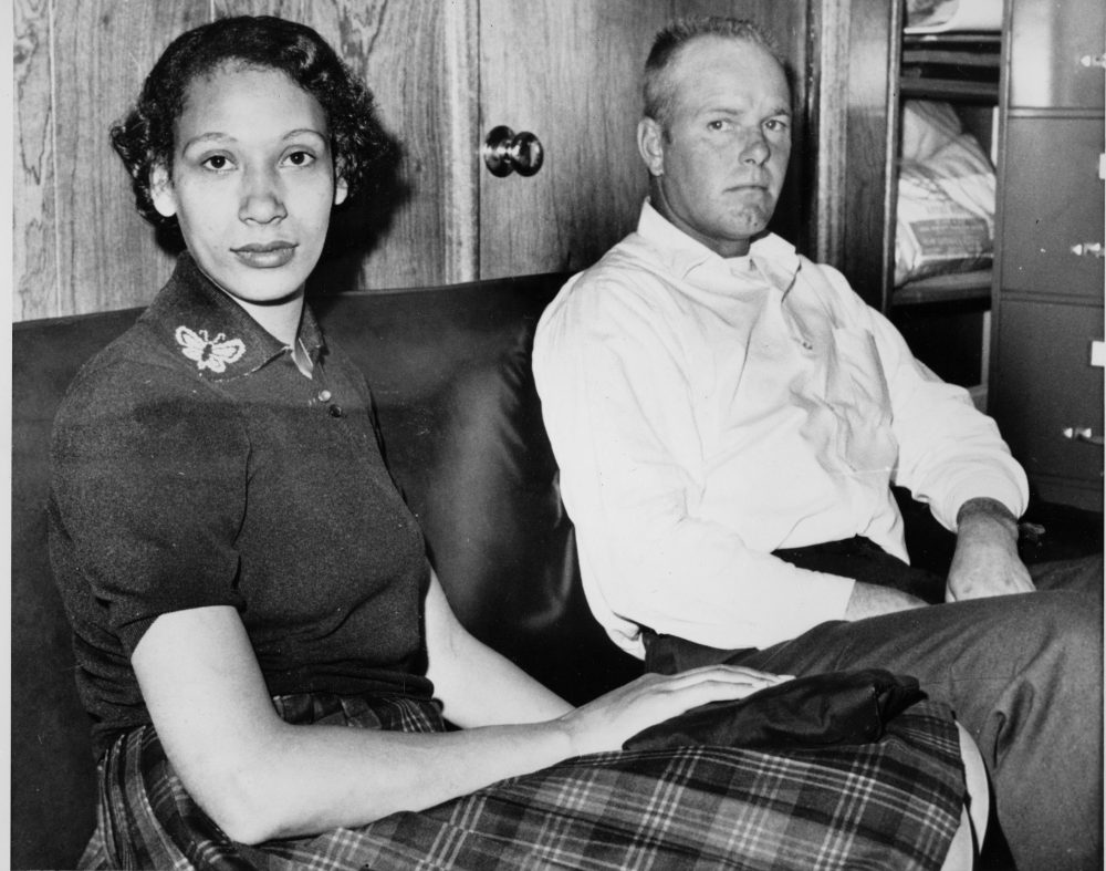 Richard P. Loving and his wife, Mildred, pose in this Jan. 26, 1965, file photograph. Residents of Caroline County, Virginia, the Lovings married in Washington, D.C., in 1958. Upon their return to Virginia, the interracial couple was convicted under the state's law that banned mixed marriages. They eventually won a U.S. Supreme Court decision in June 1967 that overturned laws prohibiting interracial unions. (AP)
