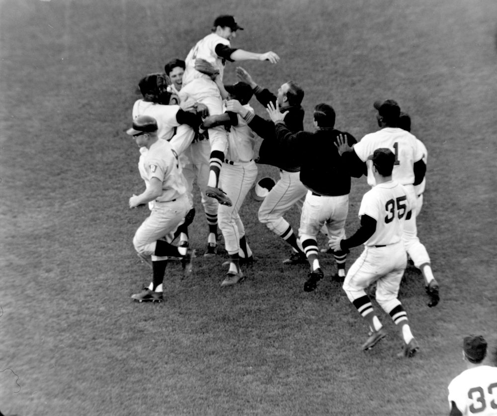 Boston Red Sox pitcher Jim Lonborg is lifted by his teammates following their 5-3 victory over the Minnesota Twins at Fenway Park in Boston on Oct. 2, 1967. (AP)