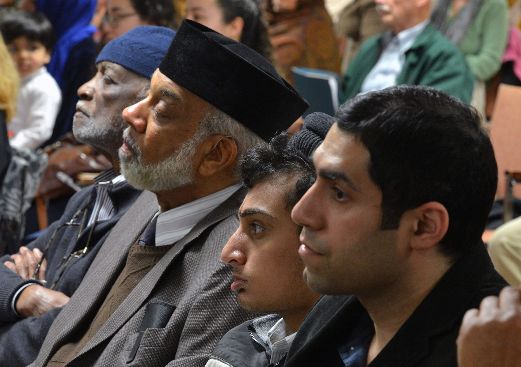 Members of the Ahmadiyya Muslim community listened as Ted Hakey apologized in the room that was marked by his bullets. (Peter Casolino/Special to the Hartford Courant)