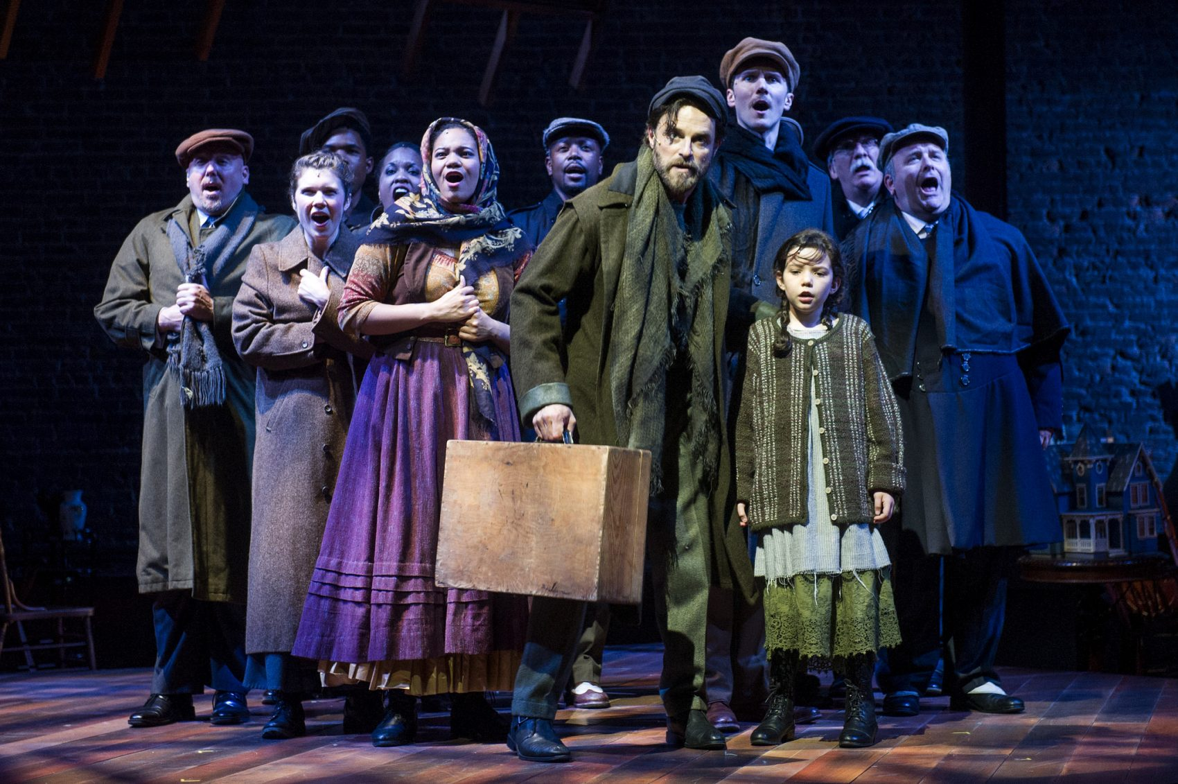 """J. Anthony Crane (center) as Tateh and the cast of """"Ragtime."""" (Courtesy of Daniel Rader/Barrington Stage)"""