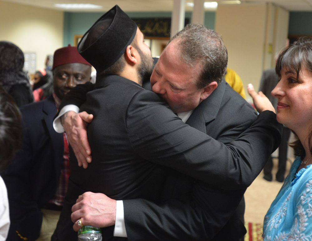 """Zahir Mannan hugs Ted Hakey at the Baitul Aman """"House of Peace"""" Mosque after Ted's apology to the Ahmadiyya Muslim community. (Peter Casolino/Special to the Courant)"""