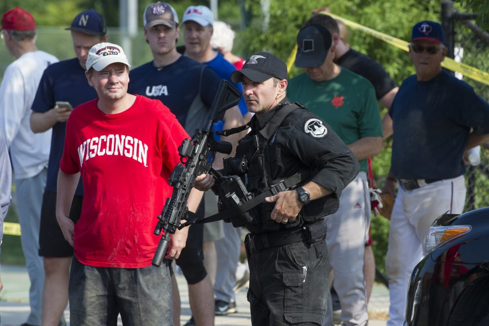 A Capitol Hill Police officer stands watch in Alexandria, Va., Wednesday, June 14, 2017, after a shooting involving House Majority Whip Steve Scalise of La., and others, during a Congressional baseball practice. (Cliff Owen/AP)