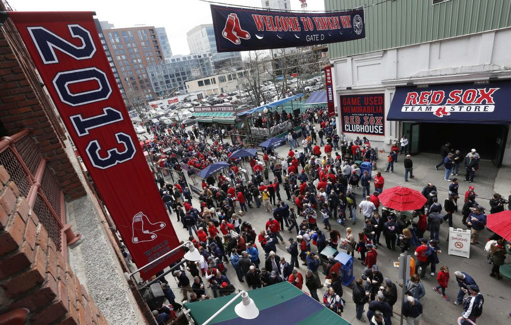 Fans enter Fenway Park on Yawkey Way before the Boston Red Sox home opener, Friday, April 4, 2014. (Michael Dwyer/AP)