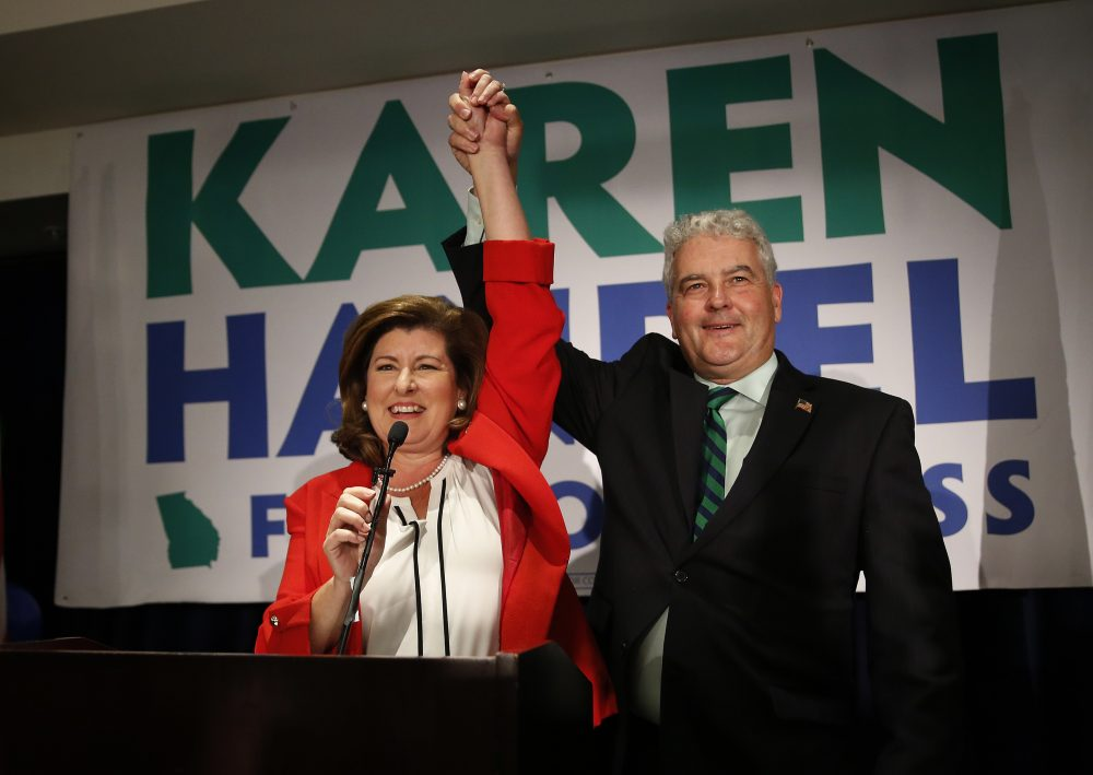 Democrats lose two more Congressional races, the Supreme Court will hear a case on gerrymandering and part of Yawkey Way becomes David Ortiz Drive. All that and more from Tom Keane's weekly news roundup. Pictured: Republican candidate for Georgia's 6th District Congressional seat Karen Handel celebrates with her husband Steve, June 20, 2017, in Atlanta. (John Bazemore/AP)