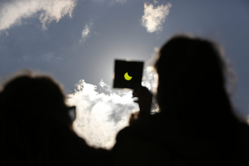 A solar eclipse is seen through a dark glass plate in Sarajevo, Bosnia , on Friday , March 20, 2015. (Amel Emric/AP)