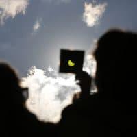 A solar eclipse is seen through a dark glass plate in Sarajevo, Bosnia , on Friday , March 20, 2015. (Amel Emric/AP)