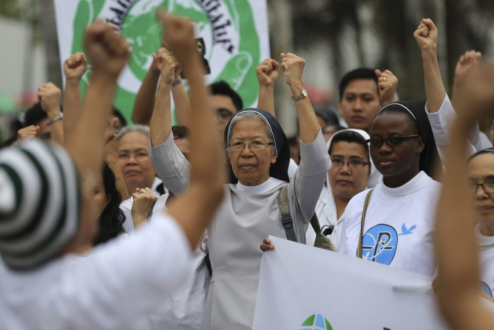 The ecological power of religion is ultimately more efficacious than the top-down power of government, writes Dan McKanan. Pictured: Filipino Catholic nuns join the Climate Solidarity Prayer March in Manila, Philippines Sunday, Nov. 29, 2015. (Aaron Favila/AP)