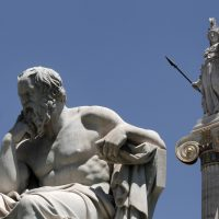 Pictured: The marble statue of Socrates in front of the Athens Academy and the statue of the ancient goddess Athena in Athens on June 5, 2012. (Dimitri Messinis/AP)