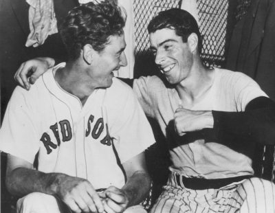 Joe DiMaggio (right) congratulates Ted Williams (left) whose ninth-inning homer defeated the National League All-Stars, 7-5, in Detroit on July 8, 1941. (AP)