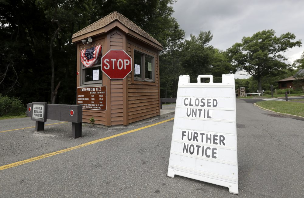 A sign sits at the entrance of Cheesequake State Park, which remains closed due to the New Jersey government shutdown, Saturday, July 1, 2017, in Matawan, N.J. (AP Photo/Julio Cortez)