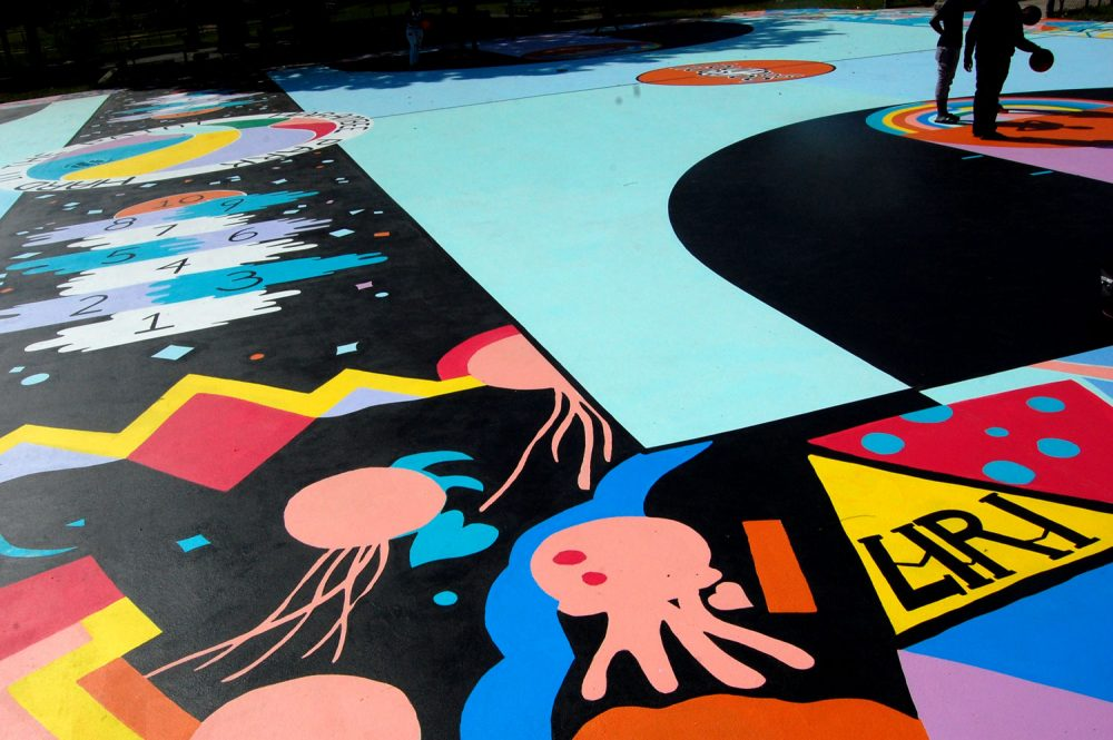 "Maria Molteni's ""Hard in the Paint"" basketball court mural at Boston's Harambee Park. (Greg Cook/WBUR)"