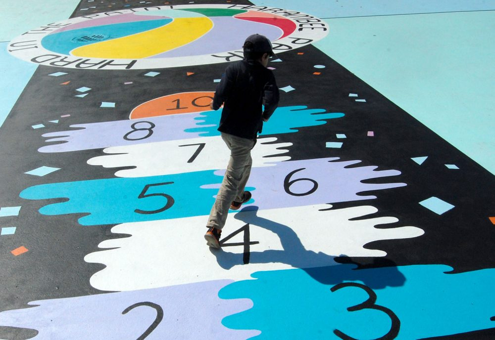 "The hopscotch court running up the middle of Maria Molteni's ""Hard in the Paint"" basketball court mural at Boston's Harambee Park. (Greg Cook/WBUR)"