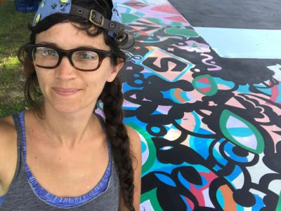 "Maria Molteni at her ""Hard In the Paint"" basketball court mural at Boston's Harambee Park. (Courtesy Maria Molteni)"