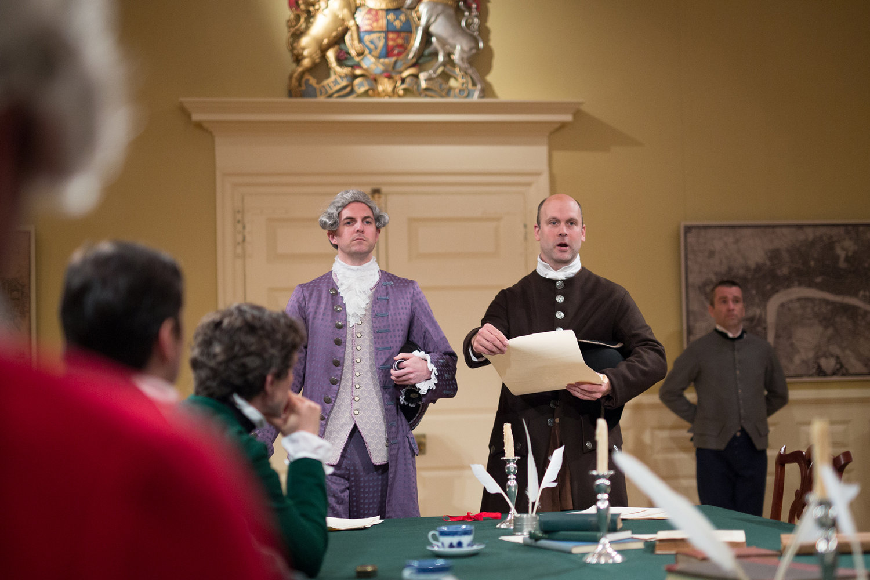 "John Hancock (Matt Ryan) and Samuel Adams (Craig Ciampa) in ""Blood on the Snow"" in the Old State House. (Courtesy Justin Saglio/Bostonian Society)"