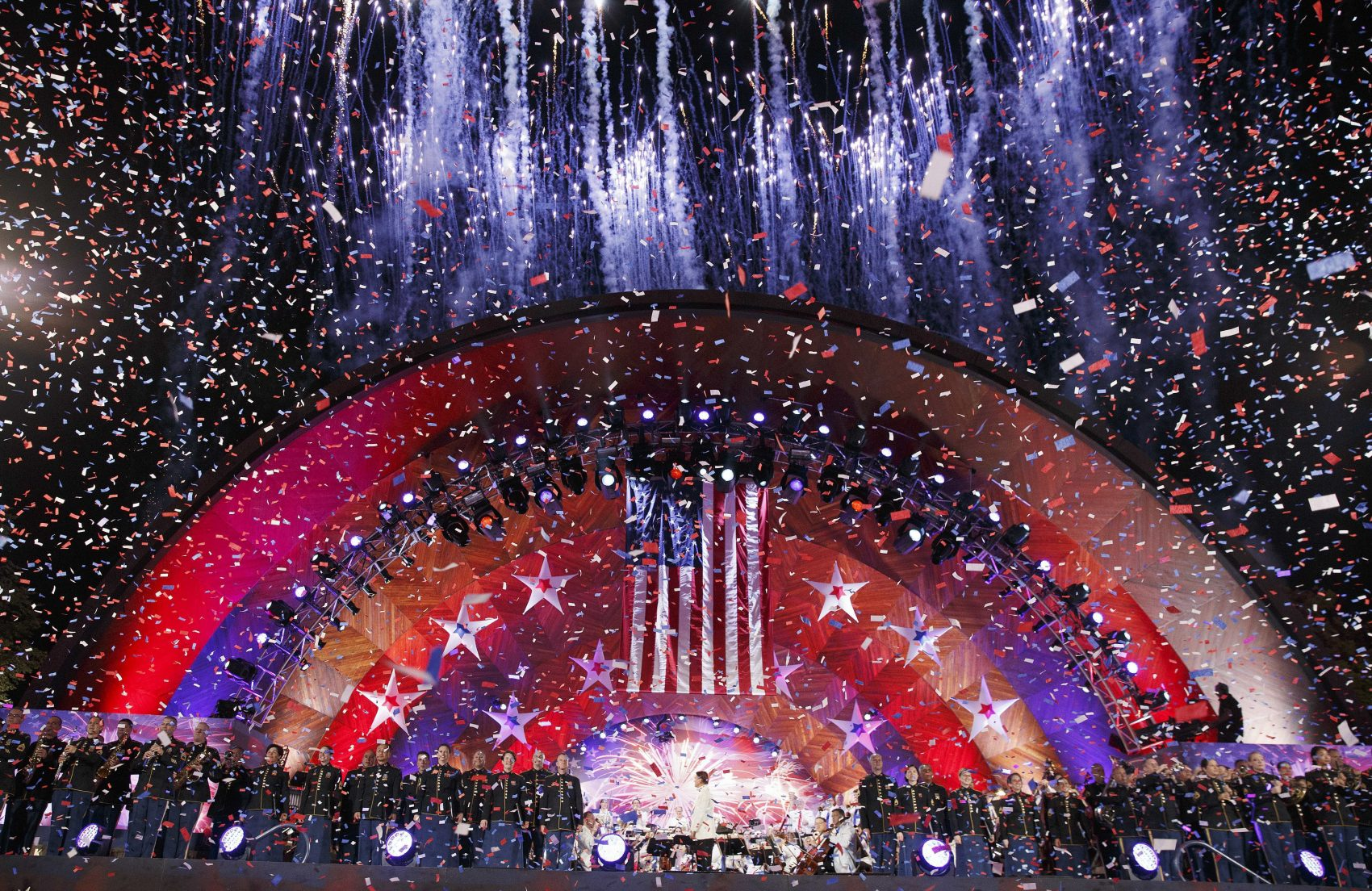 Confetti falls on the Hatch Shell during a rehearsal for the annual Boston Pops Fireworks Spectacular on the Esplanade on July 3 in Boston. (Michael Dwyer/AP)