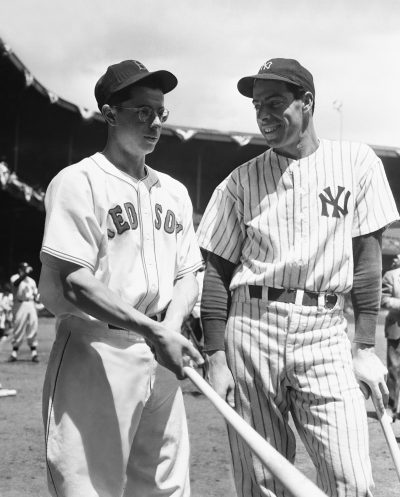 Brothers Joe DiMaggio (right) and Dominic DiMaggio speak at a spring training all-star game in 1940. (AP)
