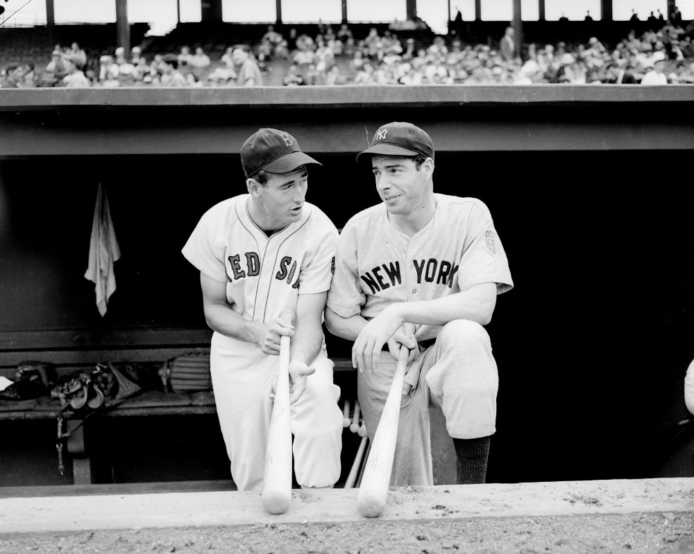 Ted Williams (left) and Joe DiMaggio (right) speak after a Red Sox-Yankees game in Boston on August 18, 1942 (Abe Fox/AP)