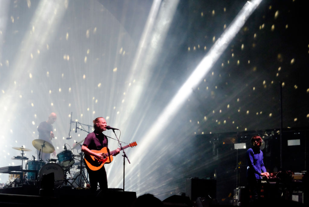 Musicians Thom Yorke (center), Jonny Greenwood (right) and drummer Clive Deamer of Radiohead perform on the Coachella Stage during day 1 of the Coachella Valley Music And Arts Festival. (Trixie Textor/Getty Images for Coachella)