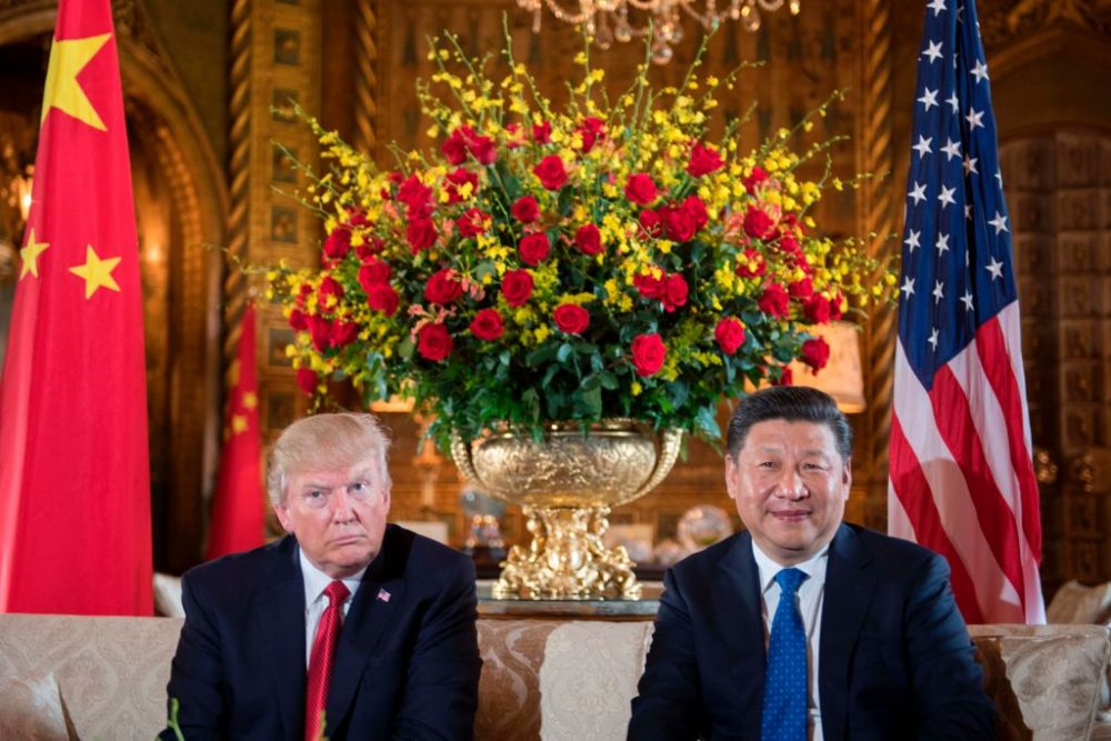 U.S. President Donald Trump (left) sits with Chinese President Xi Jinping during a bilateral meeting at the Mar-a-Lago estate in West Palm Beach, Florida, on April 6, 2017. (Jim Watson/AFP/Getty Images)