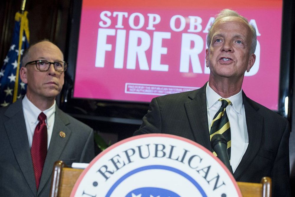 U.S. Representative Greg Walden (left) of Oregon and U.S. Senator Jerry Moran (right) of Kansas hold a press conference at Republican National Committee Headquarters in Washington, November 5, 2014. (Saul Loeb/AFP/Getty Images)