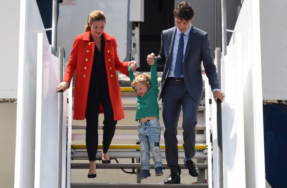 Canadian Prime Minister Justin Trudeau (right), his wife Sophie Gregoire and his son Hadrian arrive at the airport in Hamburg, northern Germany on July 6, 2017 to attend the G-20 summit.  (Christof Stache/AFP/Getty Images)
